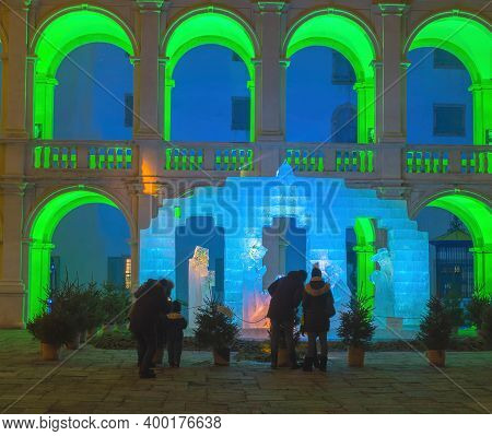 Graz,austria - December 18, 2020: People In Front Of The Traditional Ice Nativity Scene Illuminated