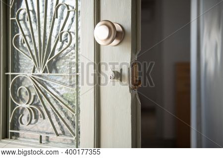 Closeup Of Old Home White Wooden Door With Stained Glass And Metal Lattice. Open Vintage Entrance Do
