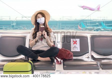 Young Asian Student College Girl Sitting At Airport Terminal Wear Medical Mask Feeling Happy With Sa