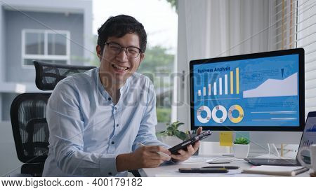 Portrait Head Shot Of Young Attractive Asian Man Sitting Smiling Work Multiple Screen Computer And S