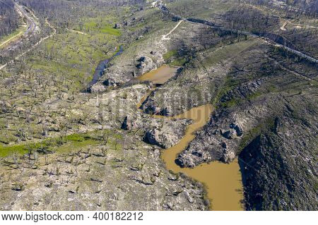 Aerial View Of A Water Reservoir Surrounded By Forest Regeneration After Bushfires In Dargan In The