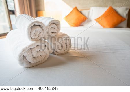 Set Of Towel On The Bed In Hotel Bedroom. Conceptual Of Hotel Amenities.