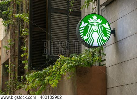Hanoi, Vietnam : March-26-2019 : Starbucks Logo Sign Setting On The Building Wall In The Downtown Of