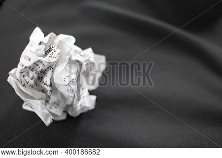 Receipts Obtained From Shopping From A Department Store Being Crumpled And Placed On A Gray Cloth Us