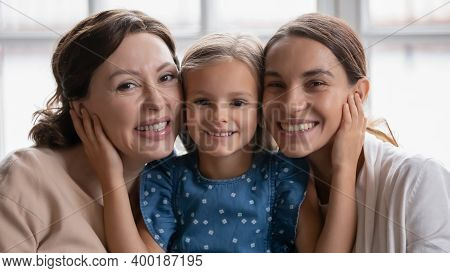 Head Shot Portrait Smiling Three Generations Of Women Posing Together