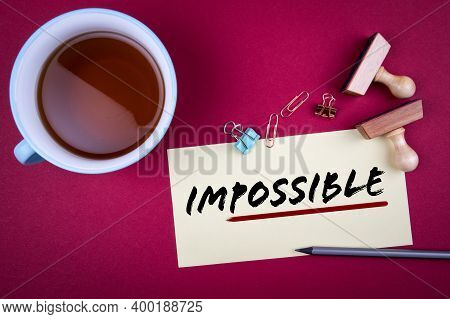 Impossible. Word Possible Underlined With A Red Stripe. Teacup, Pencil And Stamps On The Table