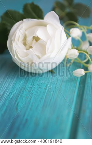 A Small Bouquet Of White Rose And Lily Of The Valley On Wooden Teal, Blue Or Turquoise Background, V