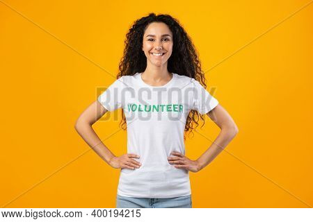 Enthusiastic Volunteer Woman Posing With Hands On Her Hips Smiling To Camera Standing Ready For Volu