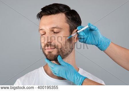 Attractive Middle-aged Man Getting Anti-aging Procedure At Clinic Or Salon, Copy Space. Cosmetician