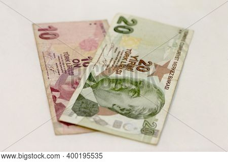Ten Turkish Lira And Twenty Turkish Lira Paper Currency Laying Isolated On The White Background