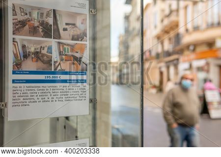 Llucmajor, Spain; December 17 2020: Showcase Of A Real State Agency. In The Unfocused Background A M