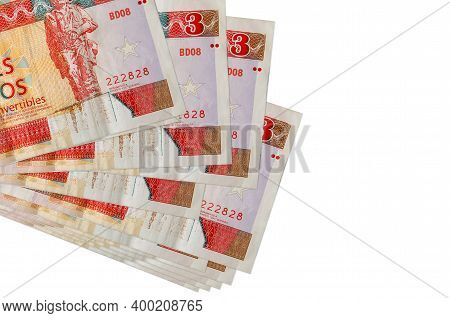 3 Cuban Pesos Convertibles Bills Lies In Small Bunch Or Pack Isolated On White. Mockup With Copy Spa