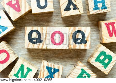 Alphabet Letter Block In Word Qoq (abbreviation Of Quarter On Quarter) With Another On Wood Backgrou
