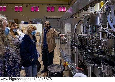 Bethlehem, Israel, December 09, 2020 : Winery Manager Shows Visitors The Production Process At The C