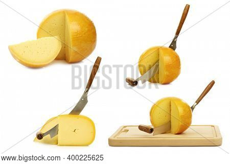 traditional Gouda and Edam cheese pieces with a cheese cutter on a cutting board