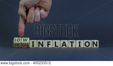 Low Or High Inflation Symbol. Male Hand Turns Cubes And Changes Words 'high Inflation' To 'low Infla