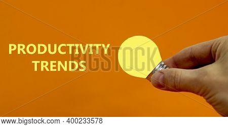 Productivity Trends Symbol. Businessman Hand Holding Light Bulb. Words 'productivity Trends'. Beauti