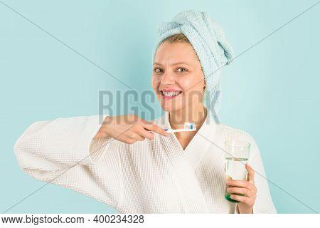 Woman Brushing Teeth In Bathroom. Teeth Care. Hygiene. Dental Higiene. Oral Care. Ceaning Teeth. Mor