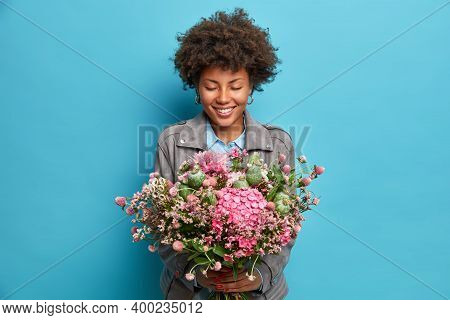 Tender Pleased Afro American Woman Florist Holds Big Beautiful Bouquet Smiles Gently Closes Eyes Pre