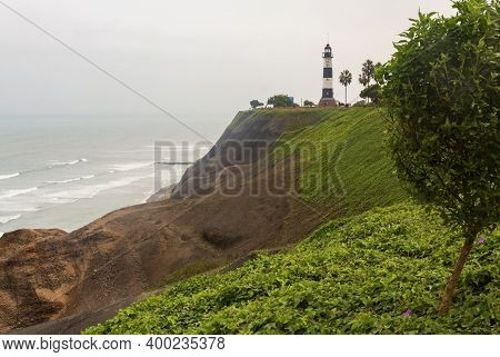La Marina Lighthouse, An Active Lighthouse Set On High Cliffs Above The Pacific Ocean, In Miraflores