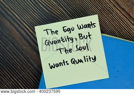The Ego Wants Quantity, But The Soul Wants Quality Write On Sticky Notes Isolated On Wooden Table. M
