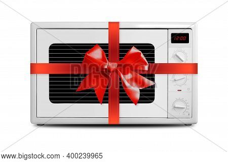 The Electric Microwave Oven Gift Tied Red Bow On A White Background. It Is Isolated, The Worker Of P