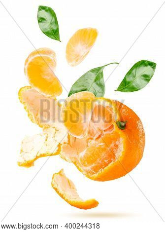 Peeled Tangerine Slices, Leaves And Rind Fly On A White Background, Isolated. Levitating Mandarin