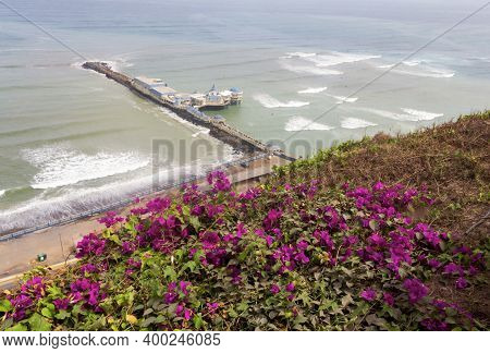 The Pacific Ocean Coastline Of Miraflores, Lima, Peru, Seen From High Above The Cliffs, Is A Popular
