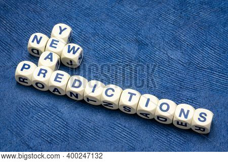 new year predictions crossword in letter dices against textured handmade paper, business forecast and expectation concept