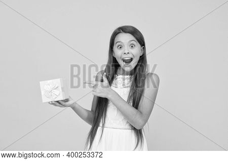 Just Perfect. Surprised Little Girl Hold Gift Box. Boxing Day Concept. Small Child On Yellow Backdro