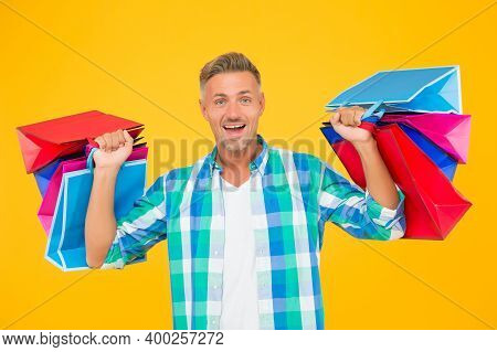 Home Shopping. Handsome Cheerful Man With Paperbags. Purchase In Paper Bags. Guy Hold Gift. Holiday