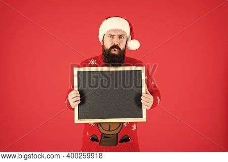 Christmas Is Coming. Hipster Hold Santa Wish List Blackboard. Bearded Man With Blank Advertising Bla