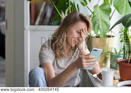 Confused Caucasian Woman Doing Facepalm Gesture, Touching Head With Palm, Looking At Screen Mobile P