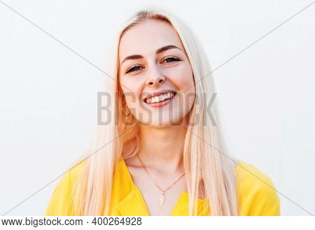 Portrait Of Young Cheerful Smiling Woman, Over White Background