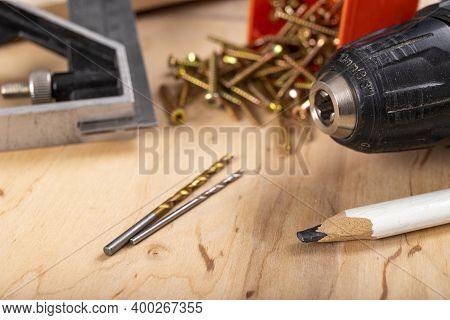 Drills And Metal Wood Screws. Minor Carpentry Work In The Workshop.