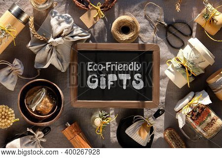 Text Eco-friendly Gifts On Blackboard. Zero Waste Christmas Gifts. Natural Warm Sunlight, Long Shado