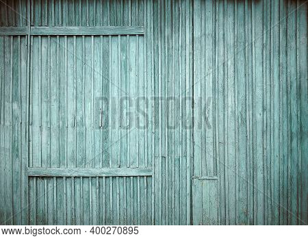Faded Texture Of A Wooden Surface Painted In Blue. Peeling Blue Paint. Bough Of A Tree. Aging Proces