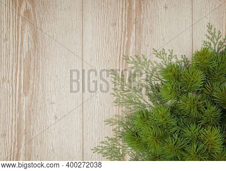 Christmas Tree Branches On Wooden Background. New Year Texture. Christmas Background And Decoration