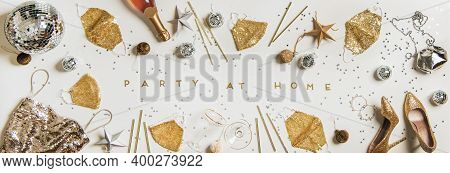 Flat-lay Of New Year Party Disco-ball, Gold Face Masks, Golden Shoes, Dress, Jewelry, Champaigne, Si