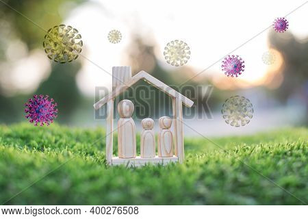 Wooden Doll Couple Stand In House Model, Self-quarantine And Stay Safe At Home Concept For Coronavir