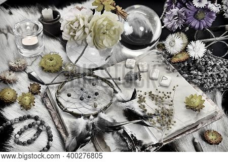 Styled Still Life With Old Diary Book, Runes, Dreamcatcher, Candle And Ritual Magic Objects On Witch