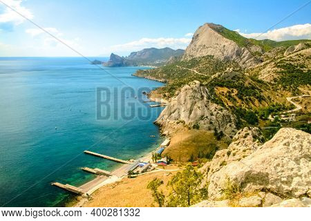 Coastline. Port city on the seashore, seascape. Bay, harbor in the bay. Beautiful sea or ocean with islands. Vacation by the sea