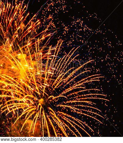 Fireworks Light Up  At New Year Eve. Abstract Festive Background With Fireworks Sparkles. Copyspace
