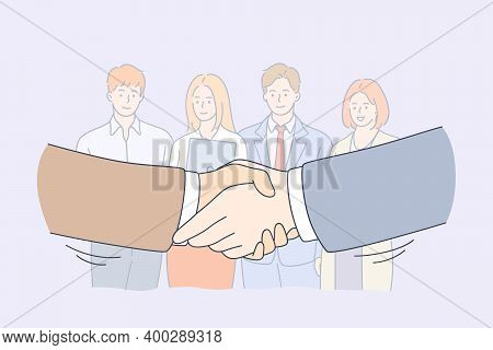 Handshake, Partnership, Business Cooperation Concept. Group Of Smiling Young Business Workers Collea