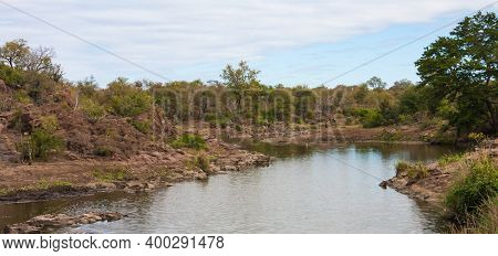 Scenic Panoramic View From Sweni Bird Hide Of The River Landscape With Birds And Hippo In The Distan