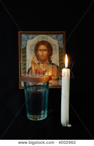 Burning Candle, Icon, A Glass With Water And Breads