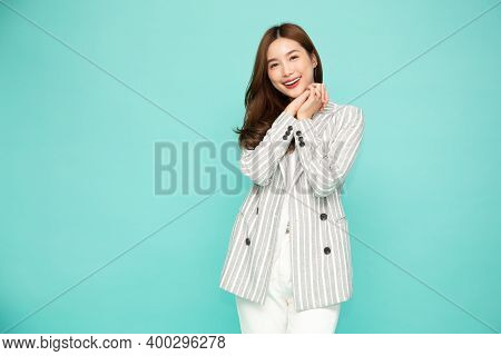 Happy Asian Woman Feeling Happiness And Feeling Excited Isolated On Light Green Background