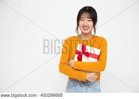 Happy Beautiful Asian Woman Smile And Holding Gift Box Isolated On White Background. Teenage Girls I