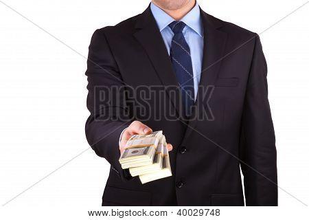 businessman holding large sum of cash