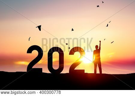 Man Raise Hand Up On Sunset Sky With Birds Flying At Tropical Beach And Number Like 2021 Abstract Ba